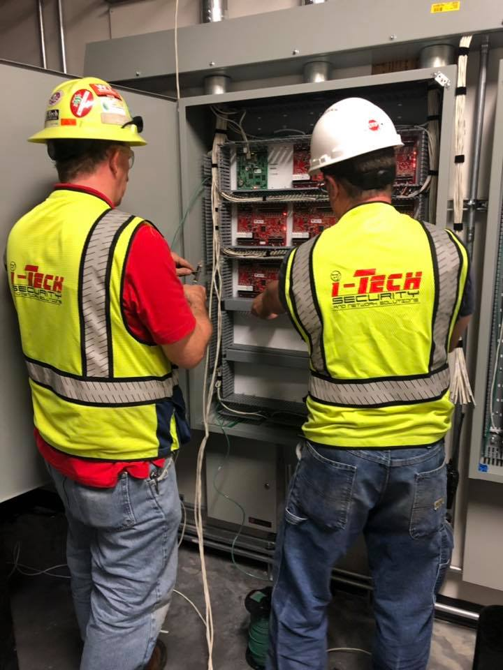 Installers working on access control panels